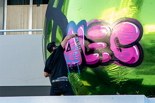 Alec Monopoly tagging helicopter