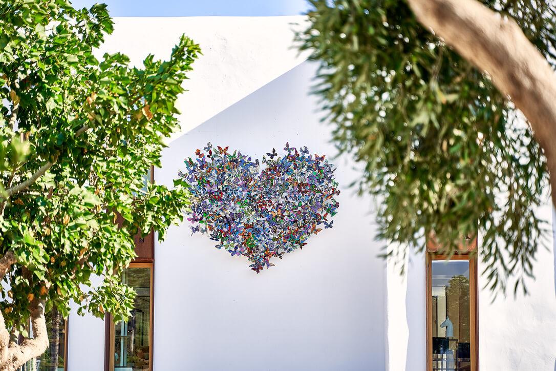 david kracov heart flutter outdoor wall sculpture