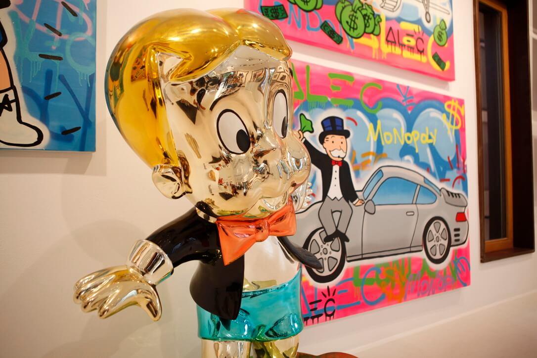 alec monopoly art sculpture richie rich